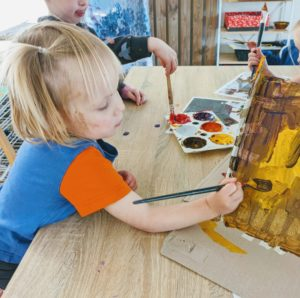 Children Painting building and panting their house
